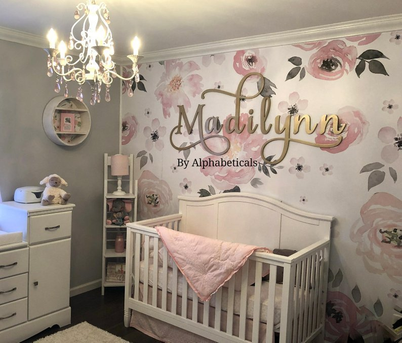 Nursery room ideas for your baby girl incorporating blush pink, ivory, grey, and white for a beautiful, romantic, and light feel for a sweet baby girl.