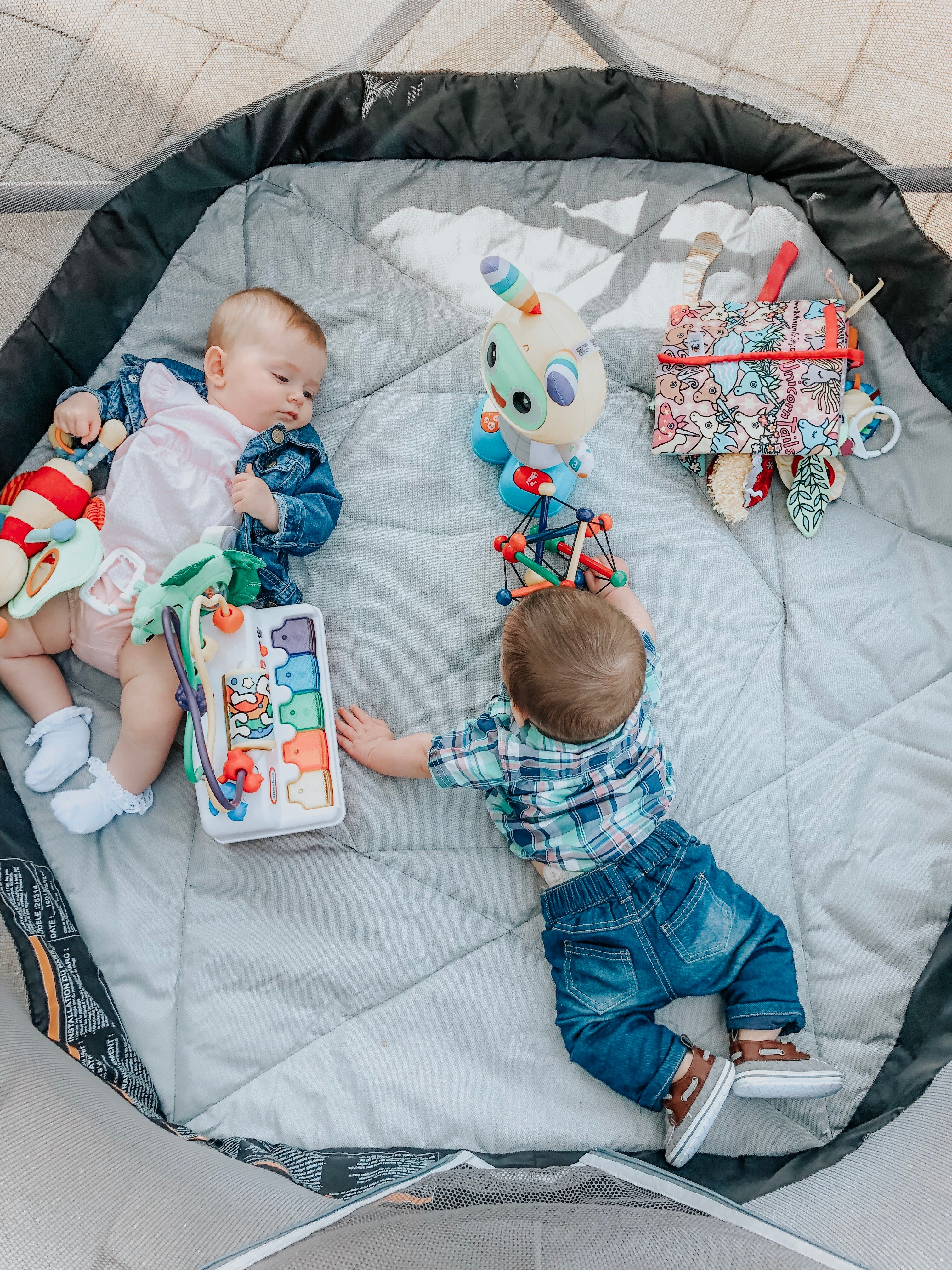 The essentails for having a baby outside in the hot summer sun. Don't leave home without some of these items to protect your baby & encourage outdoor play.