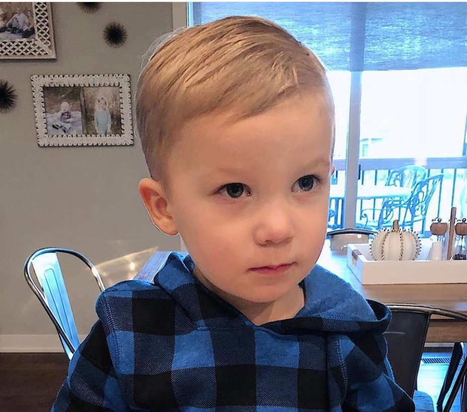 Find some adorable toddler boy haircuts for your  1, 2, or 3 year old son and give him a handsome, new look this season by trying out new hairstyles. Also find tips on cutting your toddler boy's hair at home on your own and styling it with gel to keep it tame.