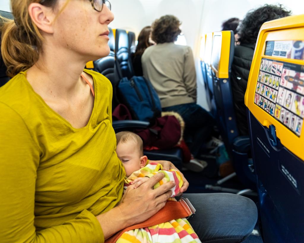mom breastfeeding on airplane